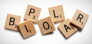 bipolar spelled with scrabble tiles